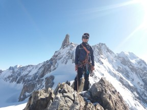 Wei Jie on the summit of Aiguille Marbrees, with ent du Geant in the background